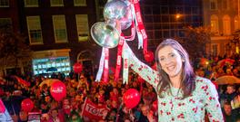 Victorious Cork ladies captain Ciara O'Sullivan raises the trophy at the homecoming in Cork city watched by thousands of supporters. Photo: Daragh McSweeney/Provision