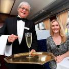 Megan Virgo is served a glass of champagne by Jimmy McNulty of the Railway Preservation Society of Ireland (RPSI). Photography: Sasko Lazarov/Photocall Ireland