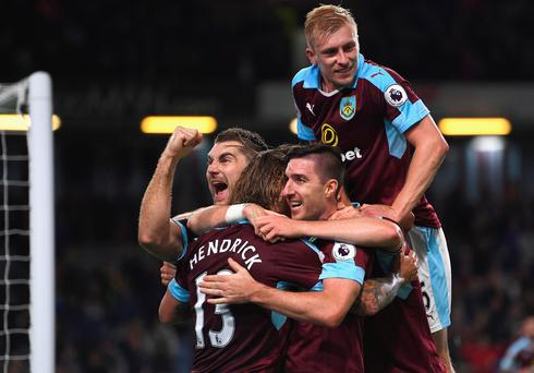 Jeff Hendrick of Burnley celebrates with team-mates after he scores his side's first goal against Watford (Photo by Laurence Griffiths/Getty Images)