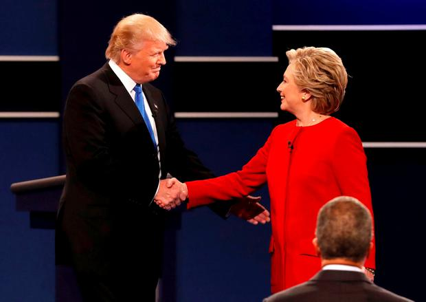 Republican US presidential nominee Donald Trump shakes hands with Democratic presidential nominee Hillary Clinton at the start of their first presidential debate at Hofstra University in Hempstead, New York