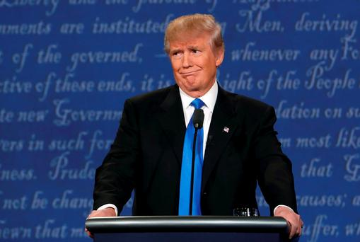Republican US presidential nominee Donald Trump reacts during the first debate with Democratic US presidential nominee Hillary Clinton at Hofstra University in Hempstead, New York
