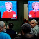 People watch the U.S. presidential debate in a restaurant in the Queens borough of New York City, September 26, 2016