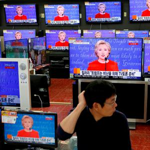 A sales assistant watches the TV broadcast of the first presidential debate between U.S. Democratic presidential candidate Hillary Clinton and Republican presidential nominee Donald Trump, in Seoul, South Korea, September 27, 2016. REUTERS/Kim Hong-Ji TPX IMAGES OF THE DAY