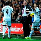 Sam Allardyce laughs at Chico Flores in 2013