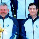 Captain Darren Clarke (C) and Rory McIlroy of Europe pose during team photocalls prior to the 2016 Ryder Cup at Hazeltine