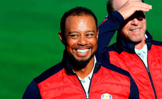 Vice-captain Tiger Woods of the United States looks on during team photocalls prior to the 2016 Ryder Cup at Hazeltine