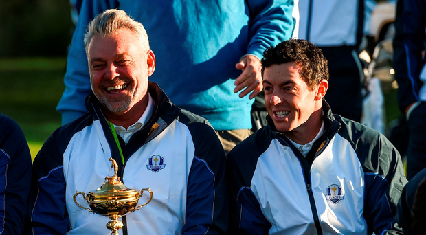 Europe team captain Darren Clarke and Rory McIlroy share a joke during the team photocall at Hazeltine. Photo: Ramsey Cardy/Sportsfile
