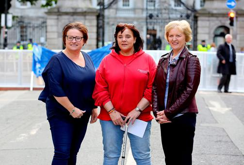 Full-time carers Shirley Thornton, Stillorgan(left), and Moira Skelly, Palmerstown (right), Dublin, with Sinead McArdle from Ardee, who struggles to get out of bed. Photo: Tom Burke