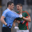 Lee Keegan gets to grips with Diarmuid Connelly. Photo: Piaras Ó Mídheach/Sportsfile