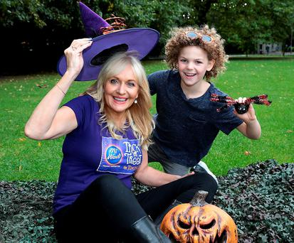 Miriam O'Callaghan gets some help from Setanta McLaughlin (9) at the launch of 'Trick or Treat for Temple Street' Photo: Brian McEvoy