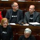 AAA TDs wear their Repeal sweatshirts in the Dáil Chamber as Ruth Coppinger questions the Taoiseach.
