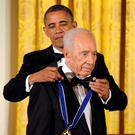 President Barack Obama awards Israeli President Shimon Peres with the Presidential Medal of Freedom at a dinner at the East Room of the White House in Washington in 2012. Photo: AP Photo/Susan Walsh