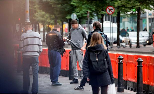 An undercover investigator buys cigarettes on Parnell Street. The deal was witnessed by an Independent.ie reporter