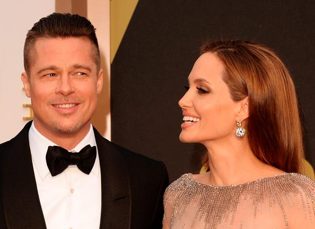 (L-R) Brad Pitt and Angelina Jolie attend the Oscars held at Hollywood & Highland Center on March 2, 2014 in Hollywood, California. (Photo by Jason Merritt/Getty Images)