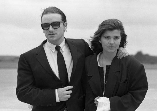 8/8/1987 Bono and his wife Ali Hewson arriving at Cork Airport prior to the U2 Joshua Tree Tour concert in Páirc Uí Chaoimh. (Part of the Independent Ireland Newspapers/NLI Colection)