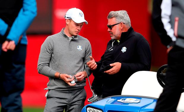 Europe's Danny Willett (left) chats with captain Darren Clarke (right) during a practice session ahead of the 41st Ryder Cup at Hazeltine