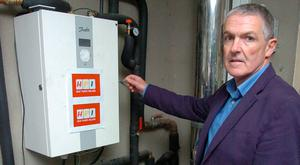 Garrett Shine with his HeatPump control unit in Blackrock, Co Louth. Photo: Seamus Farrelly