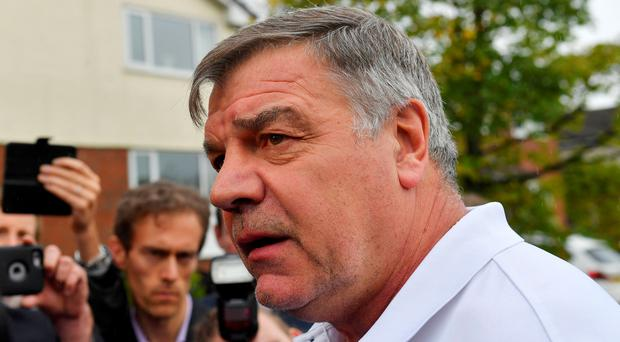 Sam Allardyce speaks to the media outside his home in Bolton