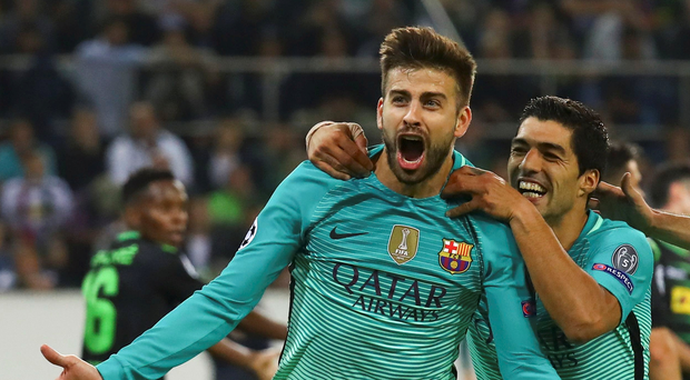 Gerard Pique is joined by Barcelona team-mate Luis Suarez after scoring the winner against Borussia Monchengladbach. Picture: Reuters
