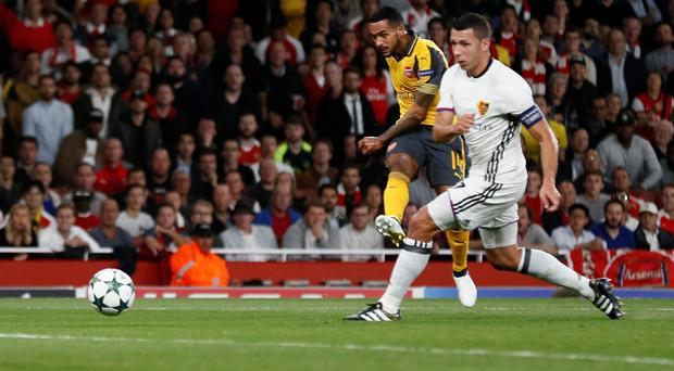 Arsenal's Theo Walcott fires his and Arsenal's second goal against Basel. Picture: Reuters
