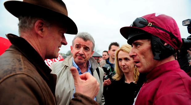 Trainer Willie Mullins and jockey Davy Russell with Michael and Anita O'Leary in 2013. Photo: Pat Healy