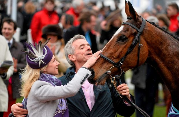 Michael and Anita O'Leary with Don Poli in the winner's enclosure at Cheltenham. Photo: Ramsey Cardy