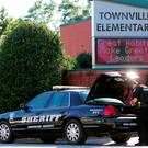 An Anderson County sheriff's deputy stands outside of Townville Elementary School after a shooting in Townville, South Carolina, U.S., September 28, 2016. REUTERS/Nathan Gray