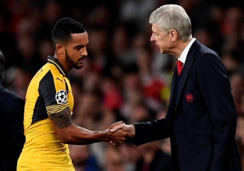 Arsenal's Theo Walcott shakes hands with manager Arsene Wenger as he is substituted