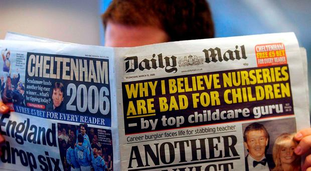 File photo dated 15/03/2006 of a man reading the Daily Mail