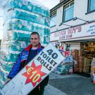Alan Buckley owner of Clever Buys Clune Road Finglas, outside his shop where a man has been defecating .