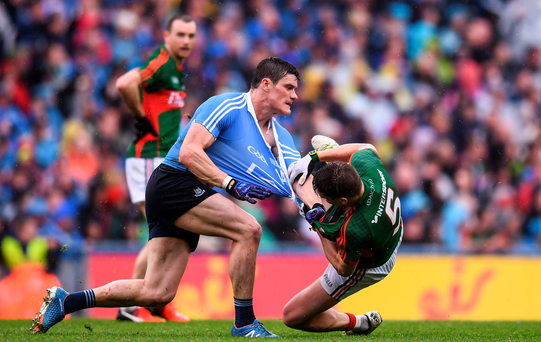 Diarmuid Connolly of Dublin tussles with Lee Keegan of Mayo