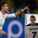 Cristiano Ronaldo's shirt is proudly held by Pierre Emerick Aubameyang's son CREDIT: GETTY IMAGES