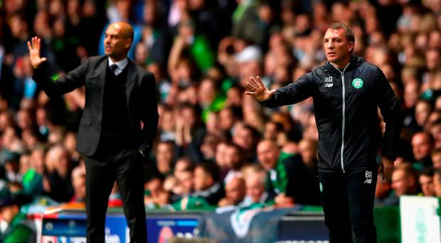 Brendan Rodgers, Manager of Celtic issues instructions to his players next to Pep Guardiola