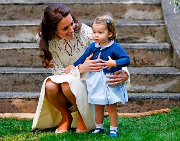 Britain's Catherine, Duchess of Cambridge, speaks to Princess Charlotte (R) as they arrive at a children's party at Government House in Victoria, British Columbia, Canada, September 29, 2016. REUTERS/Chris Wattie