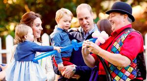 Britain's Prince William (2nd R), Catherine, Duchess of Cambridge (2nd L), Prince George and Princess Charlotte (L) watch as a man inflates balloons at a children's party at Government House in Victoria, British Columbia, Canada, September 29, 2016. REUTERS/Chris Wattie