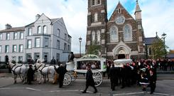 The funeral of mother-of-11 Violet Crumlish, dubbed the Queen of the Travellers, takes place at St Peter's Church in Lurgan, County Armagh.Niall Carson/PA Wire