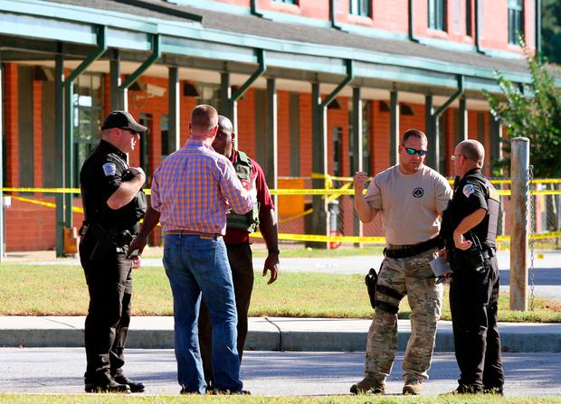 Anderson County sheriff's deputies and investigators gather outside of Townville Elementary School after a shooting in Townville, South Carolina, U.S., September 28, 2016. REUTERS/Nathan Gray