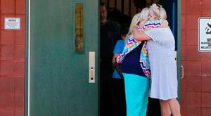 Two teachers hug outside of Townville Elementary School after a shooting in Townville, South Carolina, U.S., September 28, 2016. REUTERS/Nathan Gray