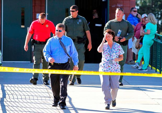 Anderson County sheriff's deputies and investigators walk out of Townville Elementary School after a shooting in Townville, South Carolina, U.S., September 28, 2016. REUTERS/Nathan Gray