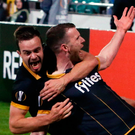 Dundalk's Ciaran Kilduff celebrates after scoring his side's winning goal with team-mate Robbie Benson in Tallaght last night. Photo: Niall Carson/PA