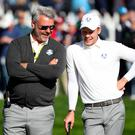 Team Europe captain Darren Clarke jokes with Danny Willett of England on the fourth green during a practice round at Hazeltine National Golf Club. Photo Rob Schumacher-/USA Today