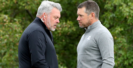 European captain Darren Clarke in conversation with Lee Westwood on the 10th tee box during yesterday's practice session. Picture: USA Today Sports