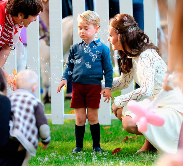 Prince George And Princess Charlotte Playing With Balloons