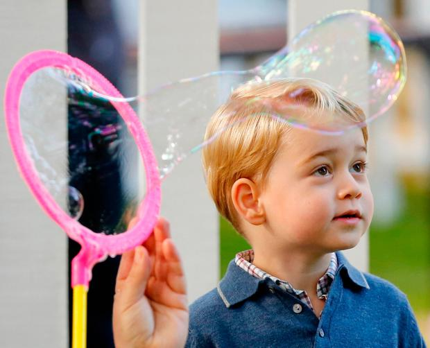 Britain's Prince George watches as bubbles are blown at a children's party at Government House in Victoria, British Columbia, Canada, September 29, 2016. REUTERS/Chris Wattie