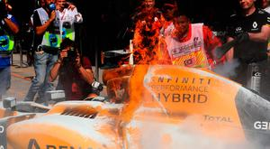 The car of Kevin Magnussen of Denmark and Renault Sport F1 on fire in the Pitlane during practice for the Malaysia Formula One Grand Prix