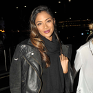 Singer and X Factor judge Nicole Scherzinger seen returning to her hotel with her assistant carrying a bottle and a glass of red wine. Pic: John Dardis