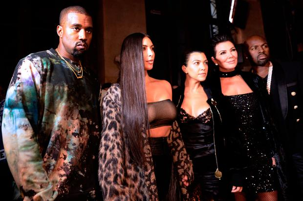 (From L) Kanye West, Kim Kardashian, Kourtney Kardashian, Kris Jenner and Corey Gamble attend the Off-white 2017 Spring/Summer ready-to-wear collection fashion show,