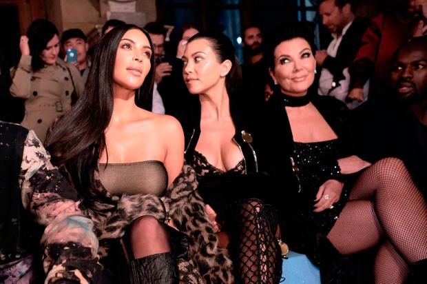(From L) Kim Kardashian, Kourtney Kardashian, Kris Jenner and Corey Gamble attend the Off-white 2017 Spring/Summer ready-to-wear collection fashion show