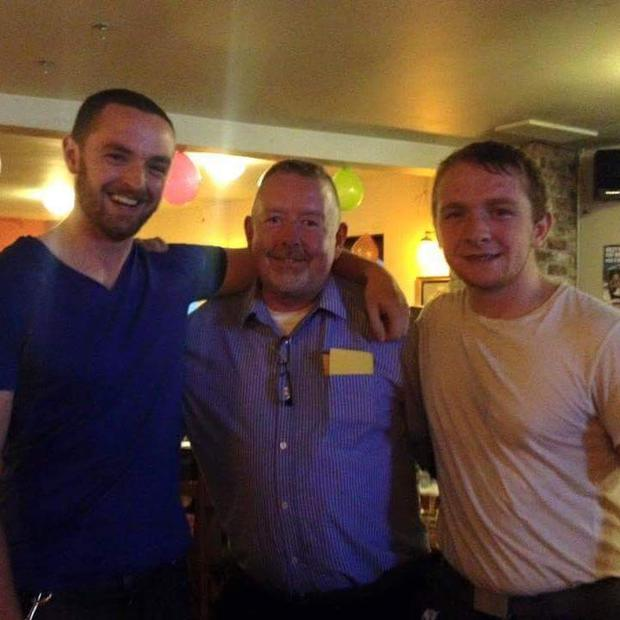 Cork brothers Derek (26) and Shane (20) pictured with their late dad James at his 50th birthday party