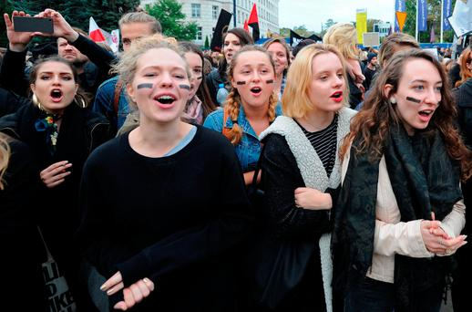 Polish government tries to calm mass outrage at abortion ban proposal